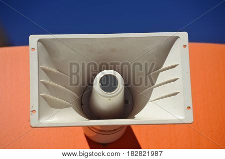 Outdoor Public Address Speaker Mounted to the top of a Railroad Train Car