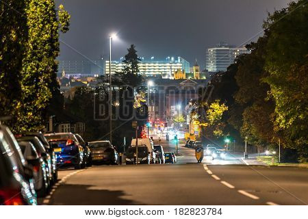 Night view of Northampton road with cityscape background.