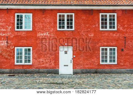 Old red house with white windows and door, Kastellet, Copenhagen, Denmark