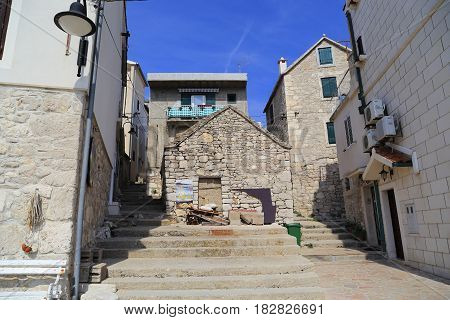 PRIMOSTEN, CROATIA - SEPTEMBER 10, 2016: These are houses and street-stairs in the old seaside resort town.