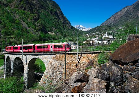 Passage to Brusio Helicidal Viaduct of the Bernina Red Train On a beautiful spring day