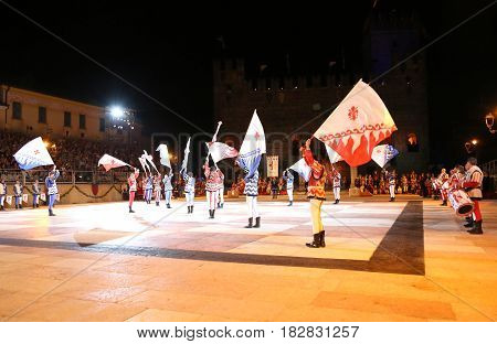 Marostica, Vi, Italy - September 9, 2016: Flag Bearers During Night Show With Evolutions Of Flags