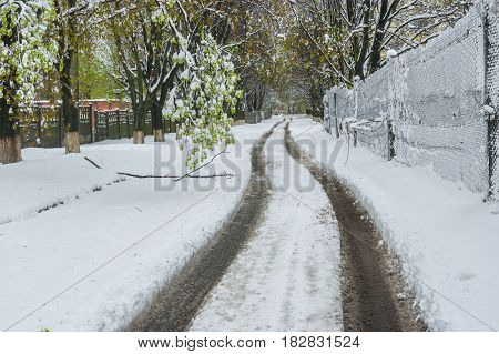 Spring landscape with road after April snow storm in Dnepr city Ukraine