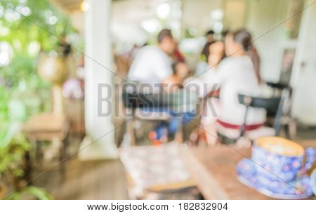 Image Of Blur Outdoor Restaurant On Day Time With Green Tree Bokeh
