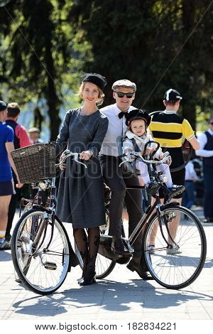 RIGA LATVIA - MAY 7 2016: Tweed ride. Unknown family with old bikes.