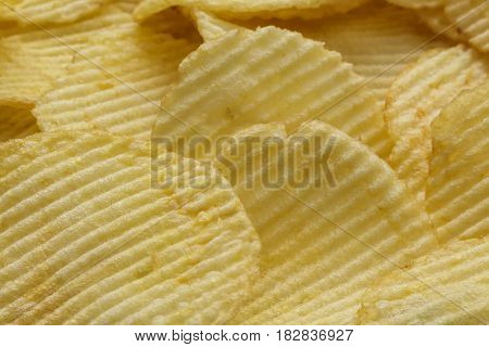 Background made of crispy ribbed potato chips