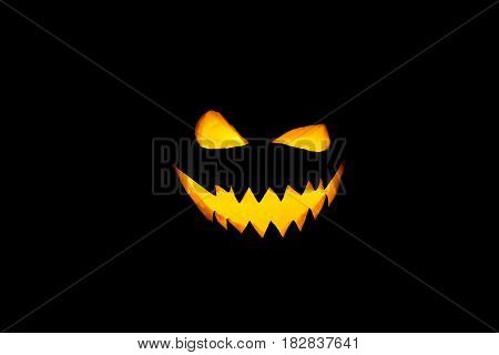 Silhouette of smiling pumpkin on black background