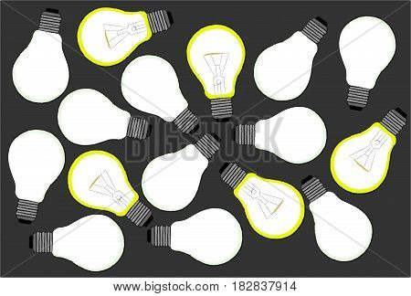 Illuminated and unlit bulbs on a gray background