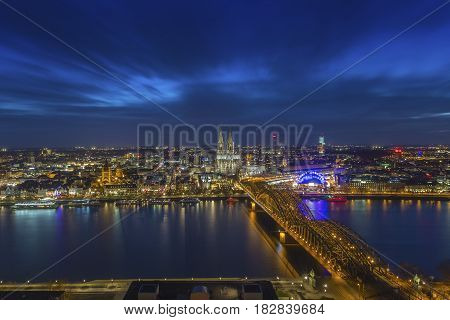 Cologne Germany - Aerial skyline view of Cologne with the beautiful Cologne Cathedral Rhine River and Hohenzollern Bridge by night