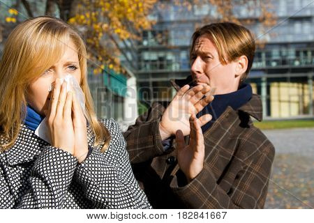 two people outdoors, extremely afraid to catch the flu from one another