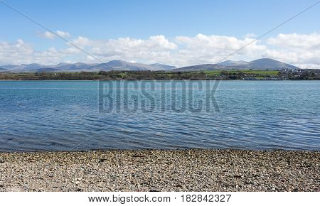 View of Snowdonia National Park from Anglesey across the Menai Straits