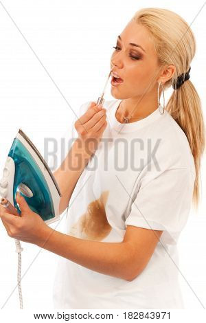 young blond woman fails ironing her tshirt and finds a better use for that shiny thingy.