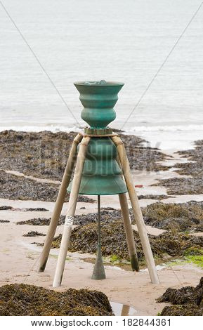 Tidal bell at Cemaes Bay in Anglesey North Wales