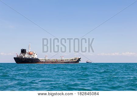 Oil transportation ship with ocean and clear blue sky background
