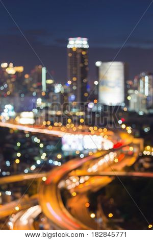 City office building blurred bokeh light with highway intersection night view abstract background