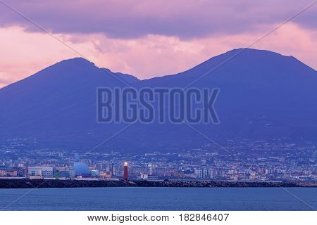 Naples Lighthouse and Vesuvius at sunset. Naples Campania Italy.