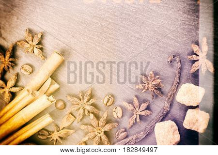 Creative Toned Background. Different Spices - Cinnamon, Vanilla, Coffee Beans, Nutmeg Scattered In C