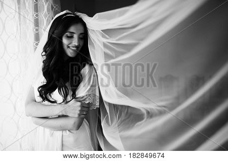 Beautiful Brunette Bride At Morning Gown Near Window At Room.