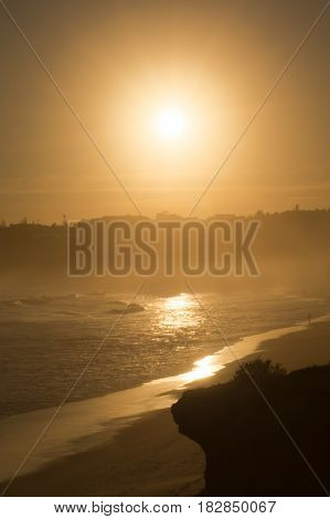 A beautiful hazy spring sunset at the beach