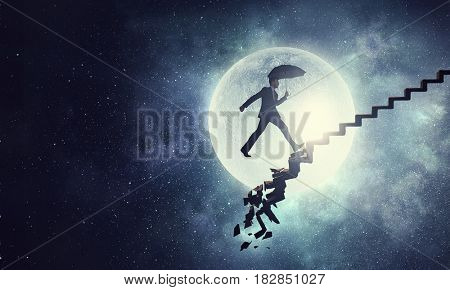 Businessman in night sky . Mixed media