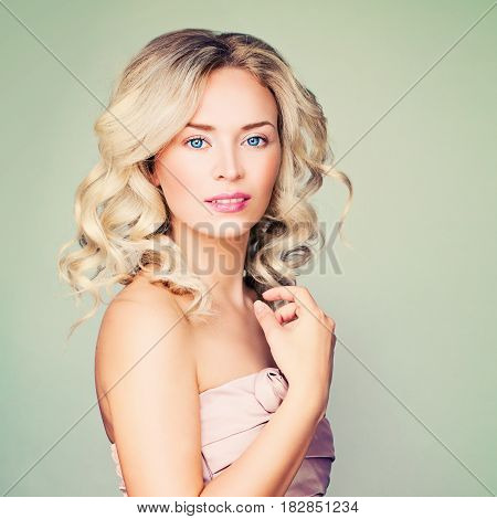 Beautiful Model Gorgeous Woman with Blonde Hair. Blonde Curly Hairstyle and Make up