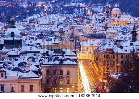 Winter in Prague - city panorama with St. Nicholas Church. Prague Bohemia Czech Republic.