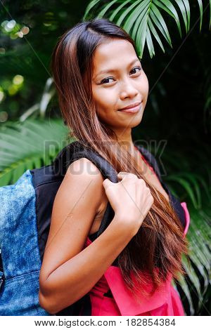 young beautiful girl in the jungle with the back pack