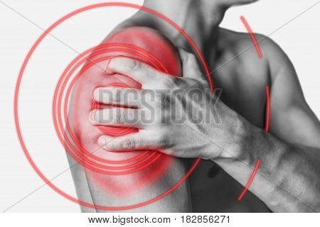 Acute pain in a male shoulder side view. Monochrome image isolated on a white background. Pain area of red color.