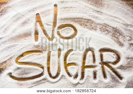 No sugar sign with letters on wooden table