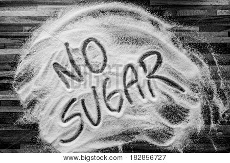 No sugar sign with sugar and wooden table