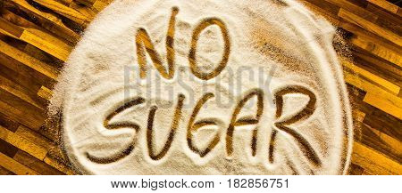 No sugar sign with wooden table tableground