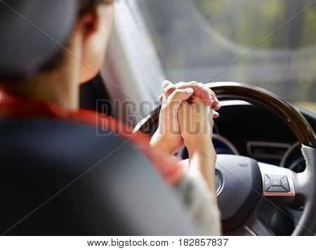woman demonstrate auto pilot while driving a car.