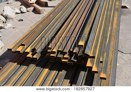 Rust steel beams iron bar on house construction site outdoor. Steel trusses for roofing.