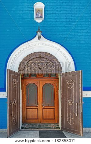 Metal forged front door leading inside the Orthodox Church
