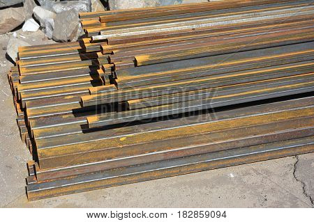 Rust steel beams on house construction site outdoor. Steel beams for roofing.