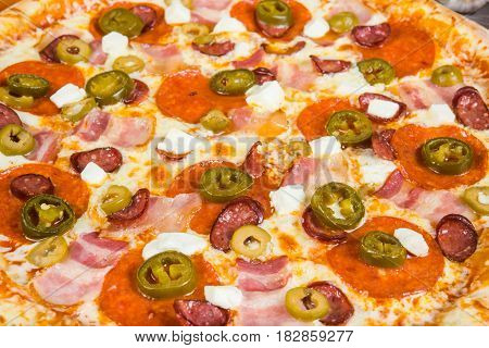 Pizza With Smoked Meat, With Rosemary And Spices On A Light Wooden Background. Italian Pizza On A Ba