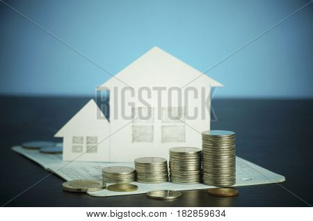pile of money coins growing up concept in business about loan sellingfinance and buying home house