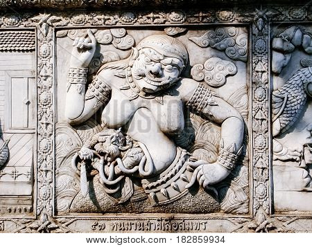 Traditional stucco style of old Thai masterpiece art on Ramayana story decorative temple wall in Wat Panan Choeng temple Ayutthaya Thailand.