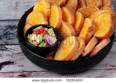 Crispy Butter Toast With Spicy Sour Sauce.