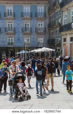 PORTO, PORTUGAL - April 17, 2017: People walking at Old Town street of Porto. Porto is the famous tourist destiantion in Portugal