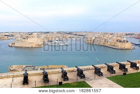 Valletta Malta: view from the Upper Barraka Gardens to the Saluting Battery and to the Grand Harbor and the Three Cities with Fort St. Angelo