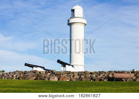 Wollongong Head Flagstaff Lighthouse, Australia, with defensive cannons placed early in Wollongong's Settlement