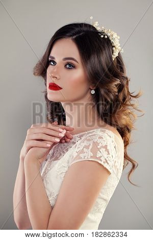 eauty Portrait of Bride with Curly Hairstyle Perfect Makeup and Jewelry. Red Lips Curly and Lace