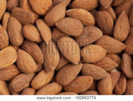 Background of nutritious almond nuts with space for text.