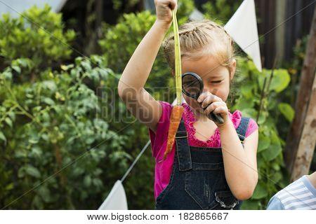 Little girl learning plant biology