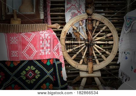 Vintage wooden spinning wheels interior items and handmade household items.
