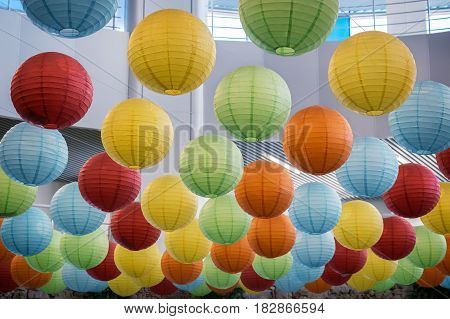 The ceiling of the building is decorated with lots of lights in the form of colorful balloons.