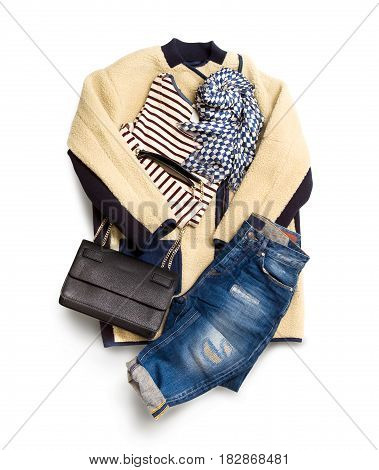 Winter woman clothes collection isolated on white background. Composition with jacket, leather bag, scarf and jeans
