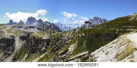 Wonderful view of the Dolomites - On background the view of Auronzo refuge (Italy): the starting point to get to the three Lavaredo's peaks.