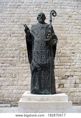 Bari, Italy - April 3, 2017: Saint Nicholas statue Bari Italy. Statue near famous Christian Basilica of Saint Nicholas.